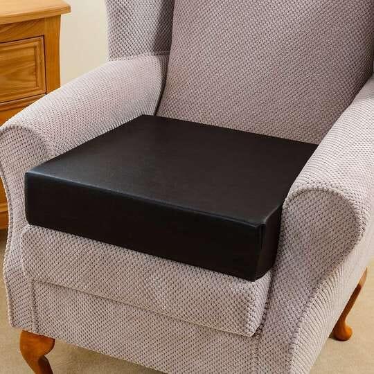 Easy Raiser Chair Cushion fitted on an armchair