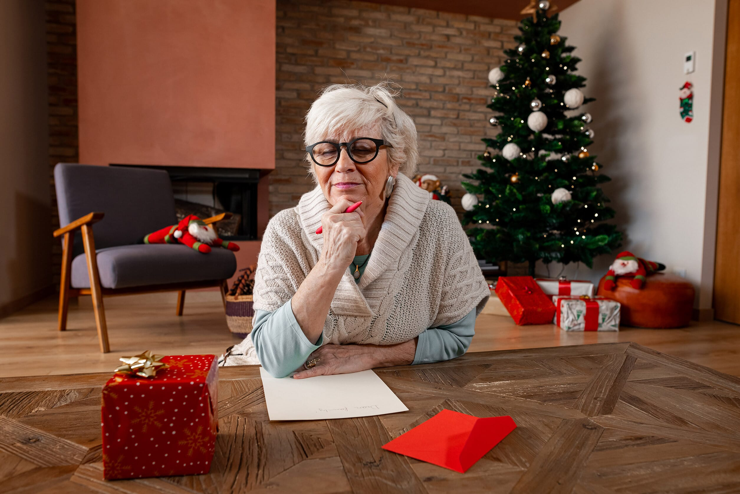 Older woman writing a letter