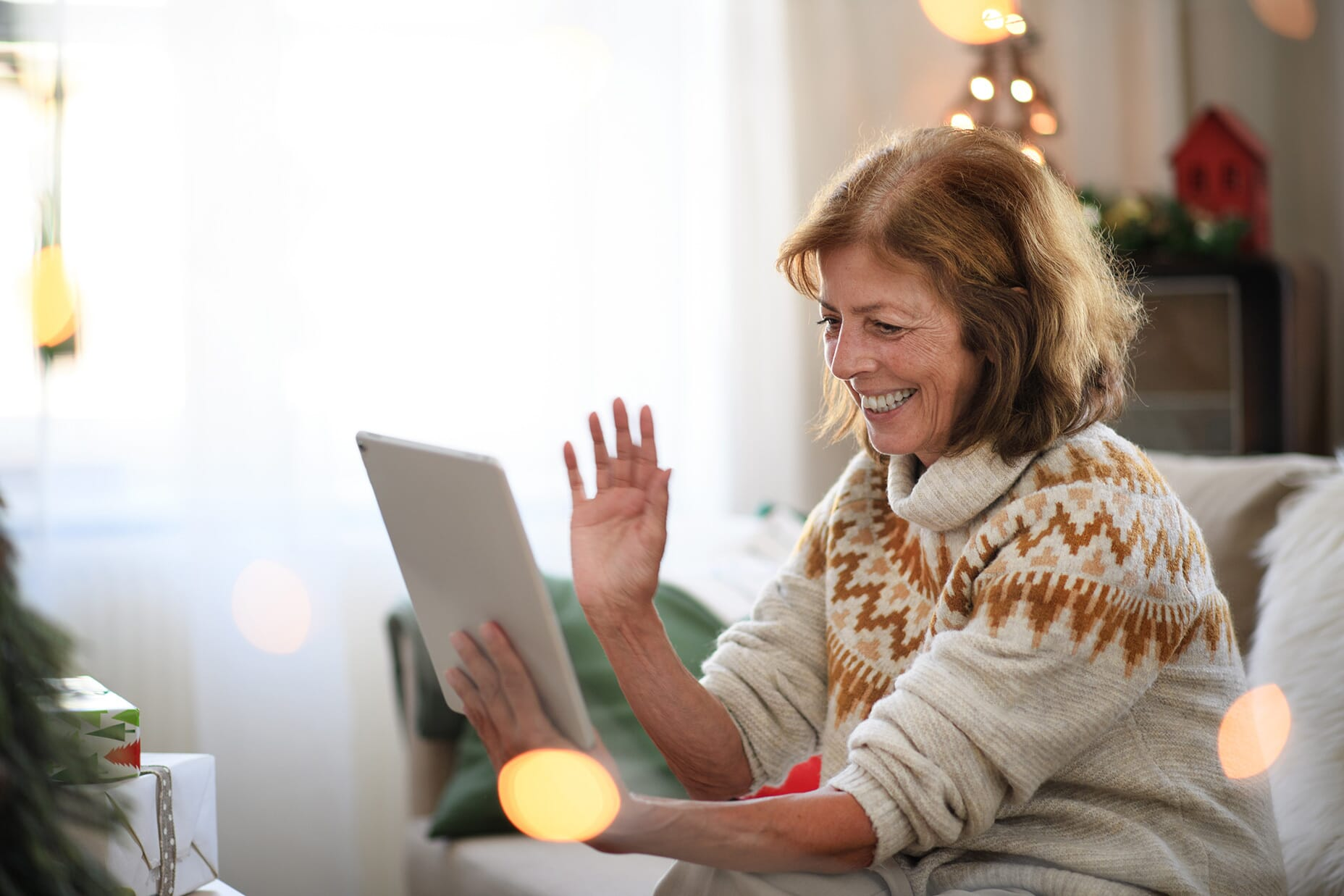 Older woman using her tablet to make a video call