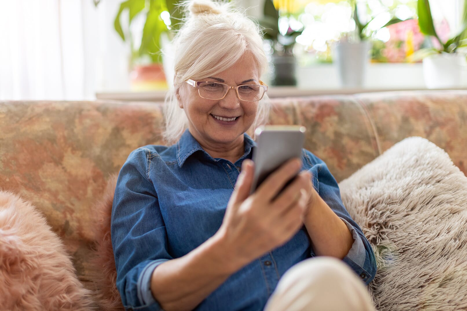 Smiling woman using her phone