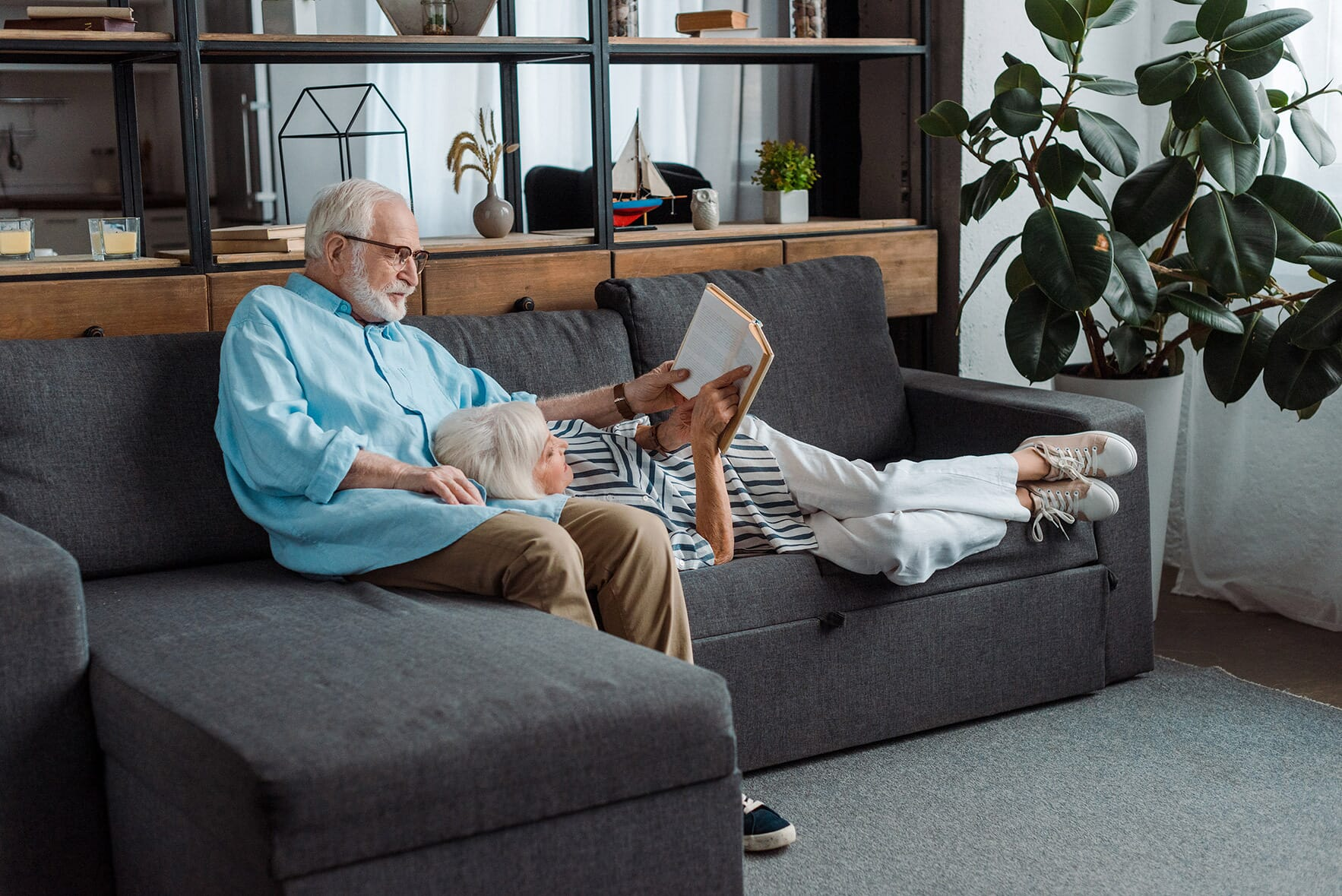 couple reading together on the sofa